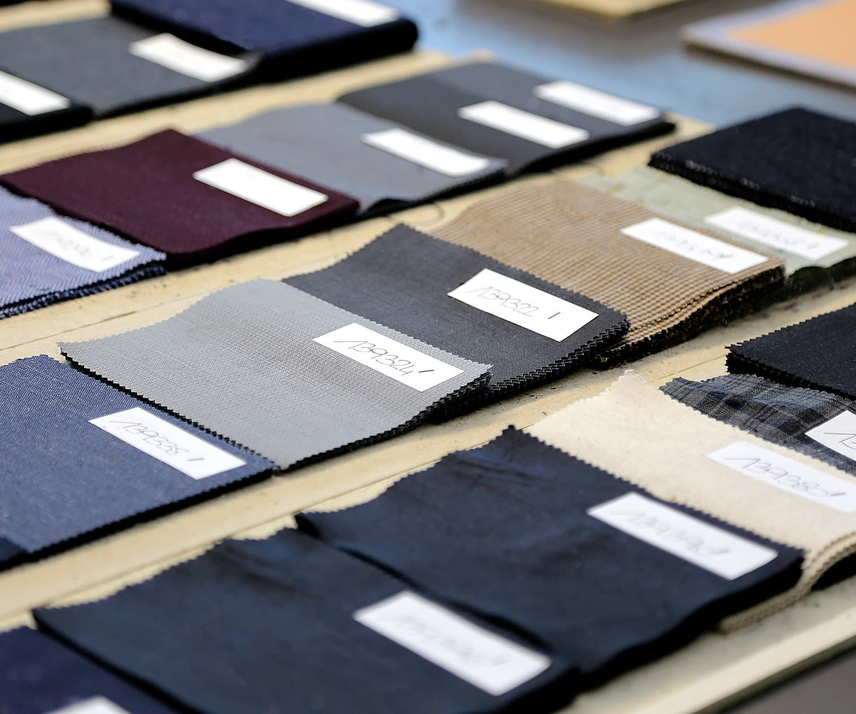 Samples of textile products as worsted wool cotton silk and other fabrics